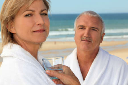 Couple wearing matching robes outdoors photo