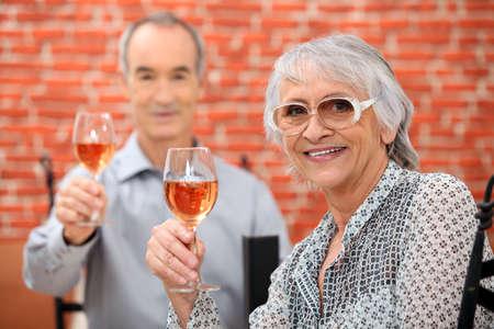 Senior couple celebrating anniversary in a restaurant Stock Photo - 11389597
