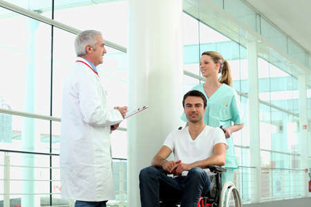 Man in wheelchair being pushed Stock Photo - 11382909