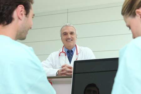 Doctor stood with nurses photo