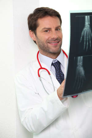 Hospital doctor examining an x-ray of someone photo