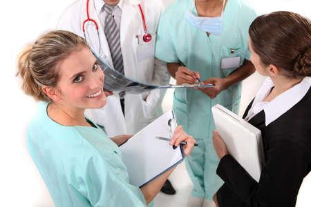 pacientes: médico y las enfermeras Foto de archivo