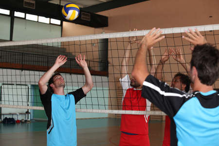 Volleyball players on indoor court photo
