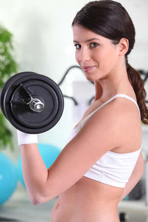 Woman lifting a dumbbell photo