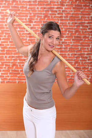 adherent: young woman doing fitness with a stick Stock Photo