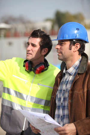 structural engineers: Architect and foreman looking at plans Stock Photo