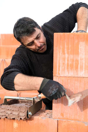 A bricklayer at work Stock Photo - 11382198