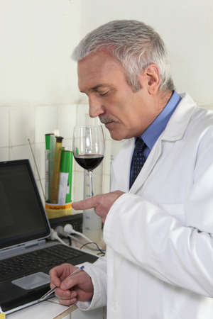 Man smelling red wine photo