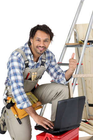 laborer: Happy laborer using computer Stock Photo