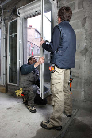 glazier: Windows being installed Stock Photo