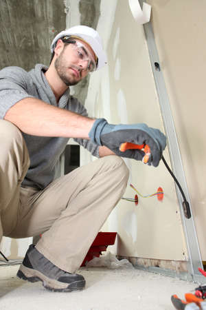 Electrician working on electrics photo