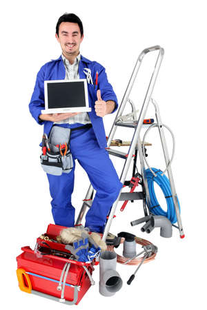 30 34 years: plumber with laptop Stock Photo