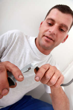 Laborer using pliers photo