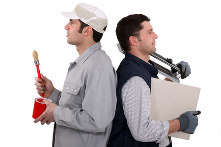 Two manual workers stood back to back Stock Photo - 11393905