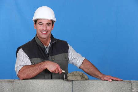 wall angle corner: Man laying bricks Stock Photo