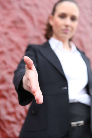 Young woman reaching out the hand for handshaking Stock Photo - 11391385