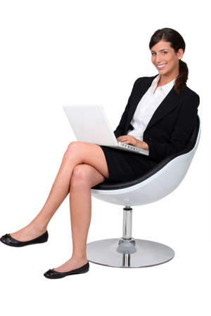 Confident businesswoman with notebook photo