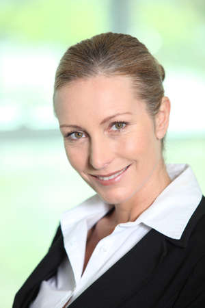 Head and shoulders of a smiling female executive Stock Photo - 11391507