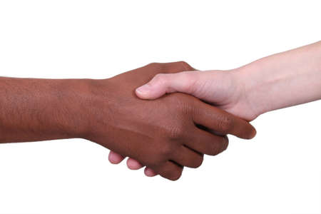 Metis person and white person shaking hands photo