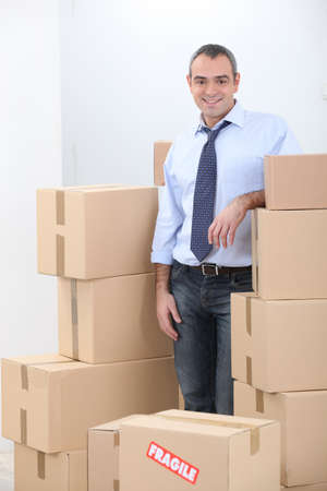 relieved: Man surrounded by boxes