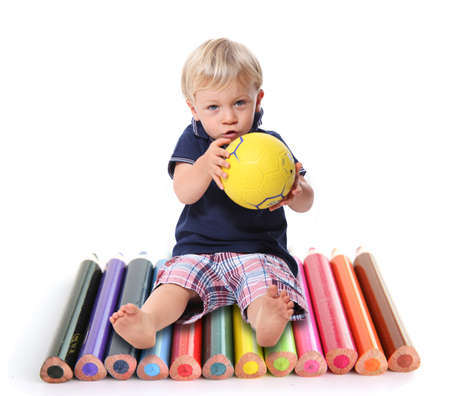 Little boy sat with colouring pencils Stock Photo - 11390575