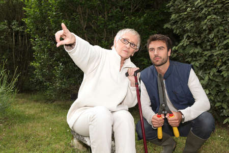 young man and older woman in garden Stock Photo - 11403724