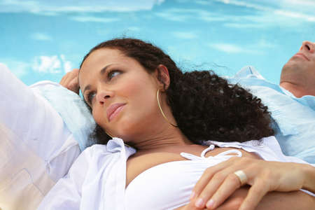 couple lying by the pool photo