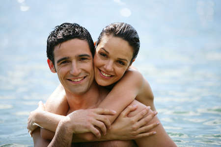 Couple hugging in the water photo