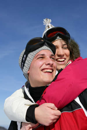 Young couple laughing on the ski slopes Stock Photo - 11391349