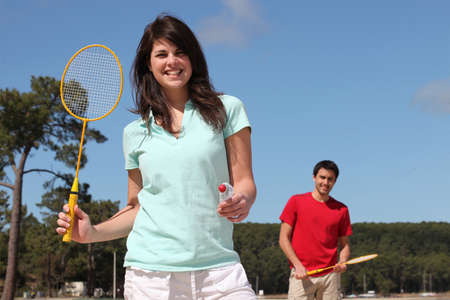 A couple playing badminton photo