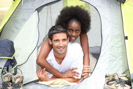 interracial couple in a canvas tent photo