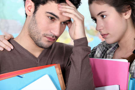 Student offering support to a stressed friend Stock Photo - 11402842