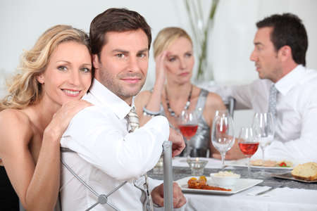 disharmony: Dinner party discussions Stock Photo