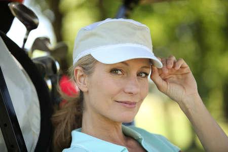 Closeup of a female golfer photo