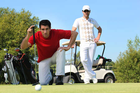 Golfer kneeling. Stock Photo - 11399056