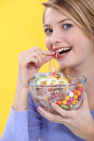 Young woman eating sweets photo
