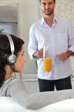 oj: Man getting glass of juice