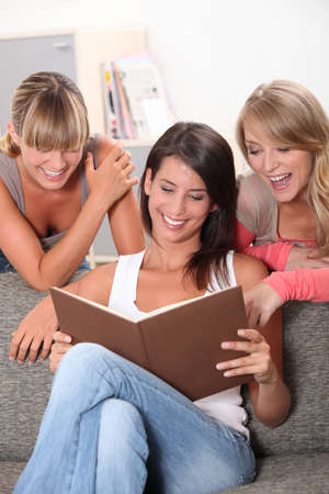 Women looking at book Stock Photo - 11403644