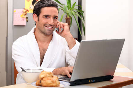 modern businessman having breakfast at home photo