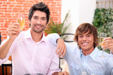 Men drinking champagne in a bar photo