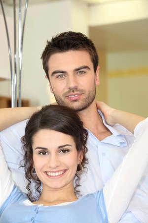 Affectionate couple on sofa photo