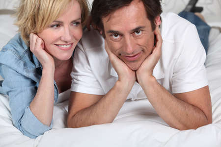 accomplices: couple on bed