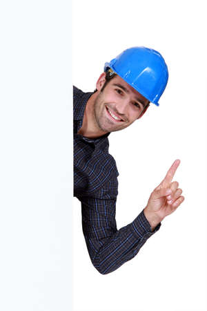 A construction worker rising his finger. photo