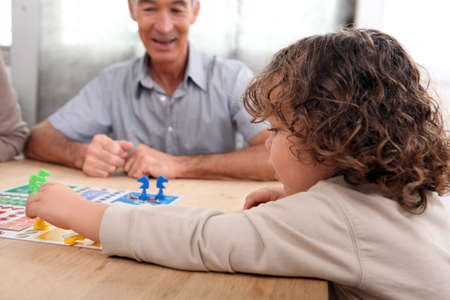 conviviality: Young child playing a board game