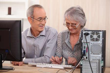 Cheerful senior couple browsing on the Internet photo