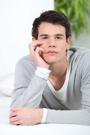 impassive: Bored young man at home Stock Photo
