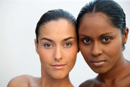 Two beautiful Caucasian and African women photo