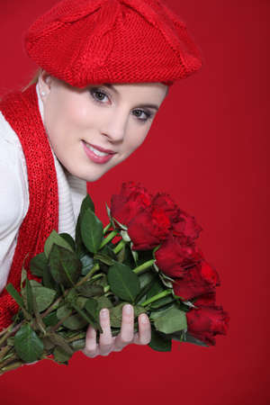 young woman holding a bouquet of roses photo