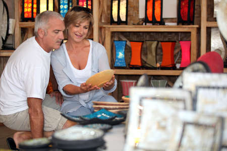 Couple looking at local pottery on holiday photo