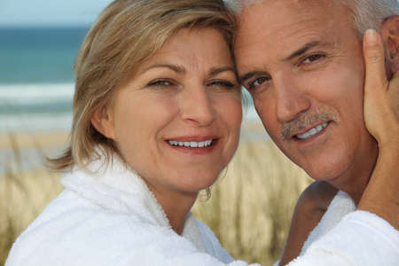 50 55 years: Couple enjoying a relaxing holiday by the seaside Stock Photo